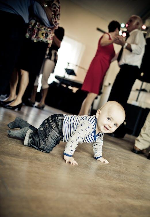 Toddler Crawling on Floor