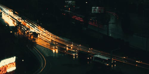 Long-exposure Photograph of Vehicles on the Road