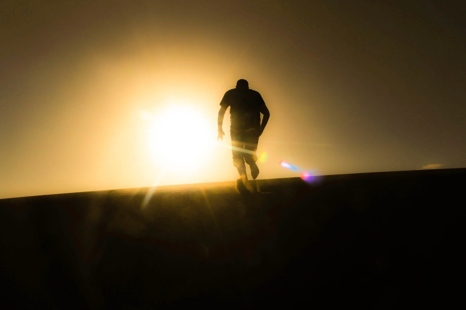 Rear View of Silhouette Man Against Sky during Sunset