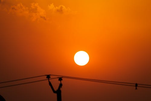 Foto stok gratis matahari terbenam yang indah