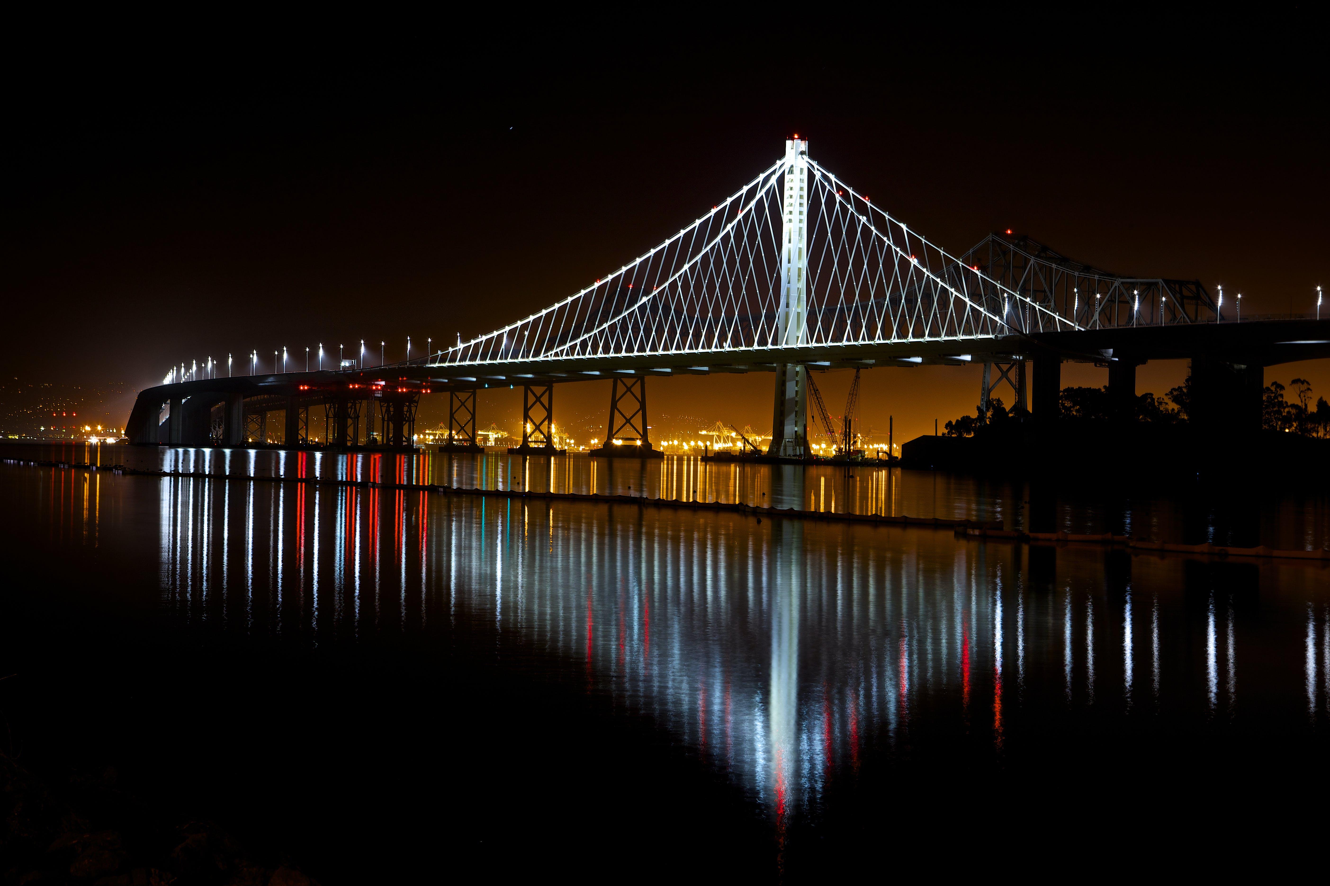 Illuminated Suspension Bridge Against Sky at Night