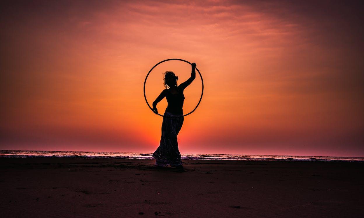Silhouette Boy on Beach Against Sky during Sunset