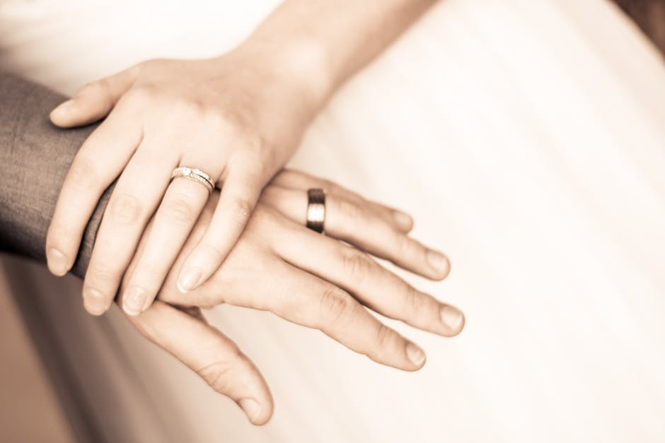 Close-up of Couple Holding Hands · Free Stock Photo