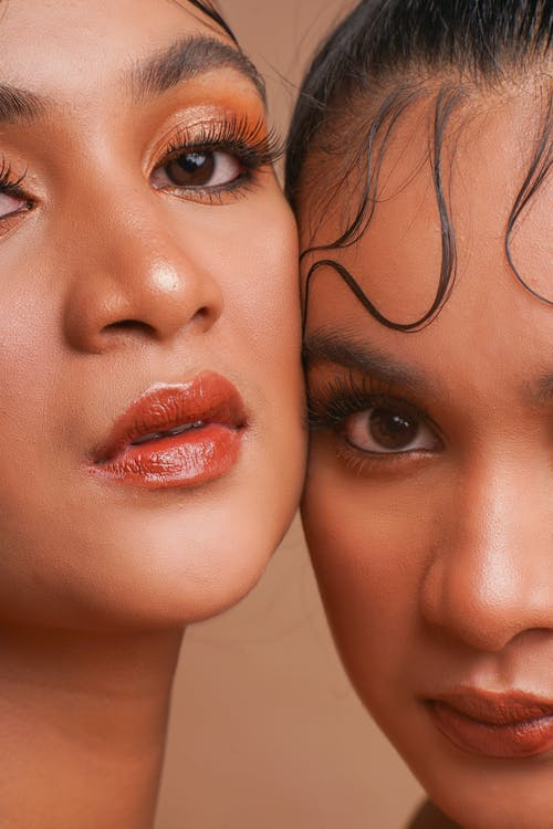Close Up Photo of Two Women
