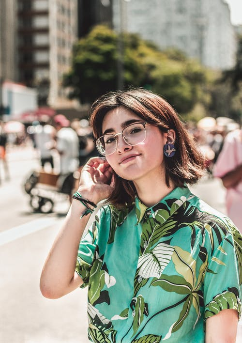 Selective Focus Photography of Woman Wearing Green Floral Button-up Shirt