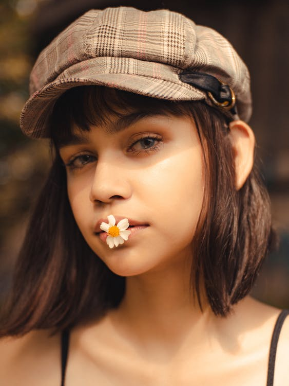 White-petaled Flower on Woman's Mouth