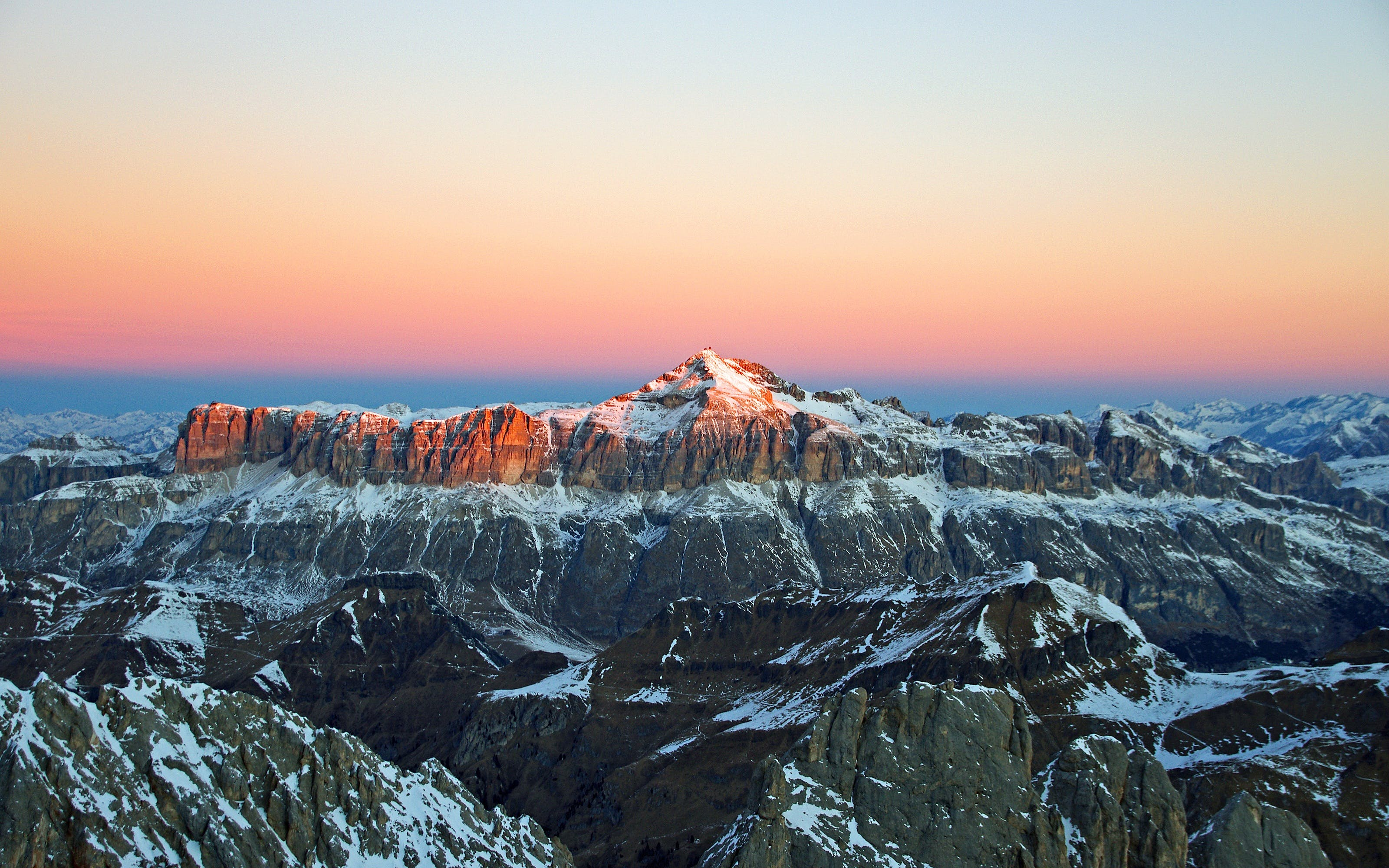 View of Snow Covered Mountain during Sunset