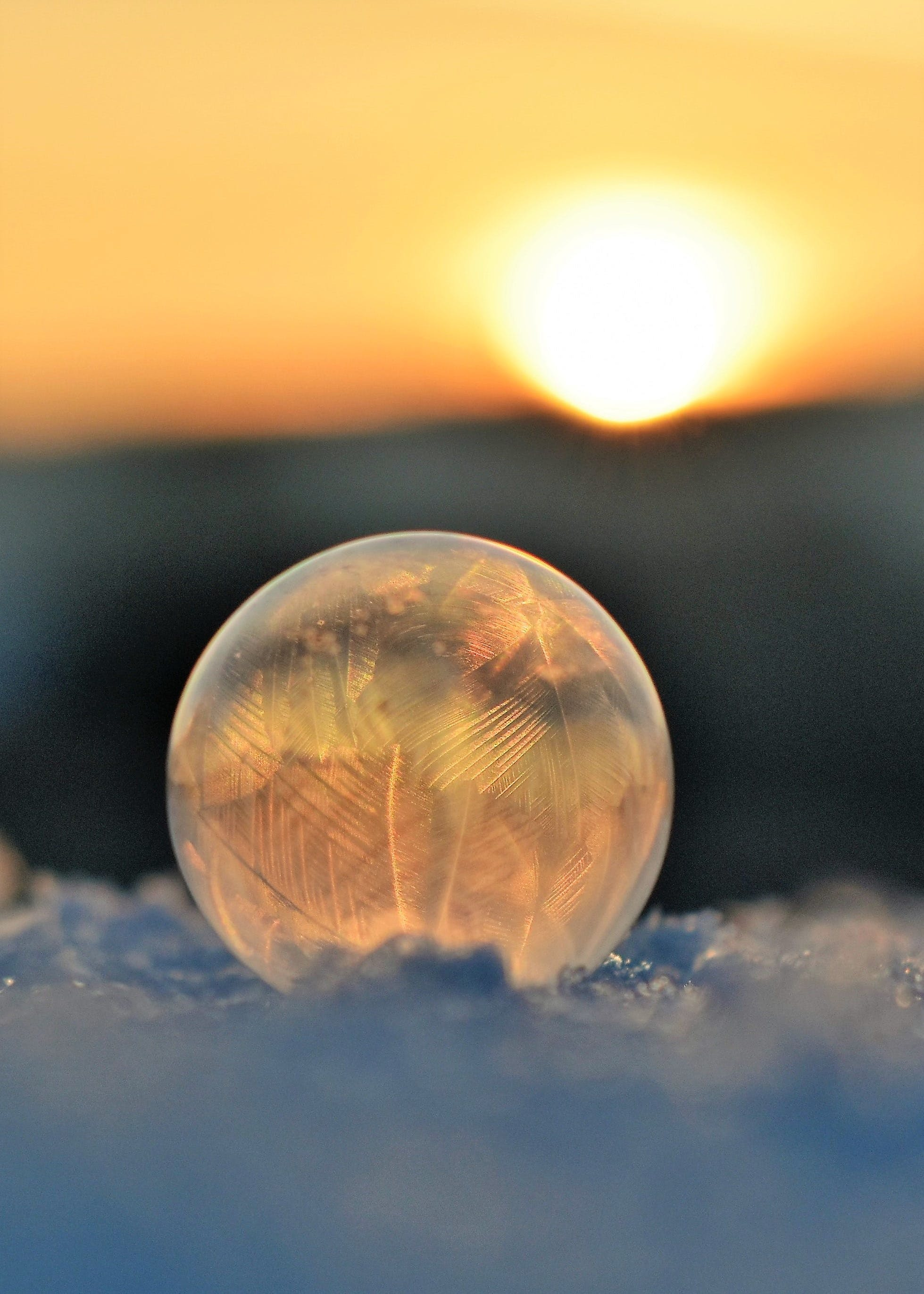 Frozen Soap Bubble Against Sky during Sunset