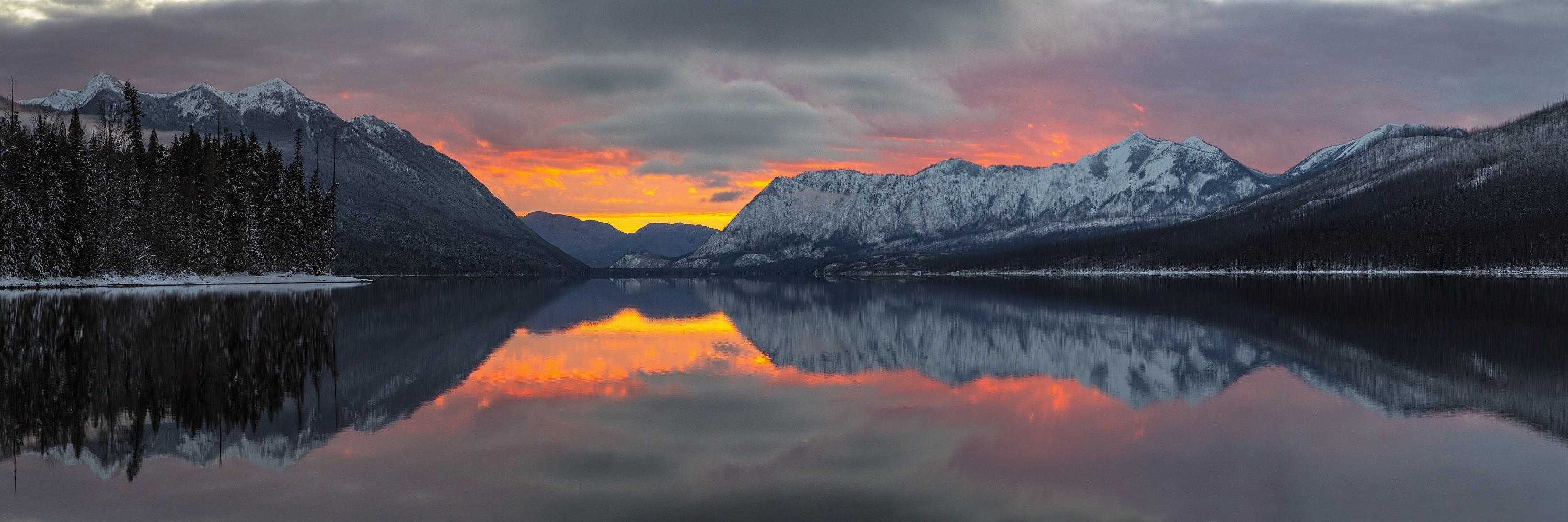 Reflection of Mountains in Lake during Sunset