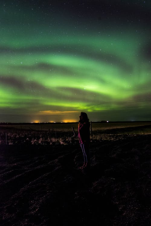 Person Looking at the Northern Lights