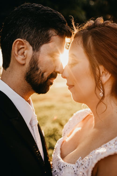 Couple About to Kiss Against the Sunrays