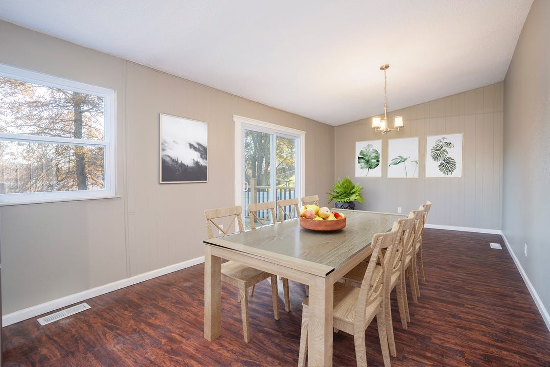 Photo Of Dining Table On Top Of Wooden Floor