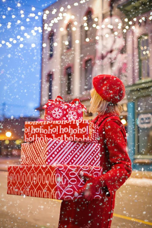 Woman Holding Three Red Christmas Presents Boxes