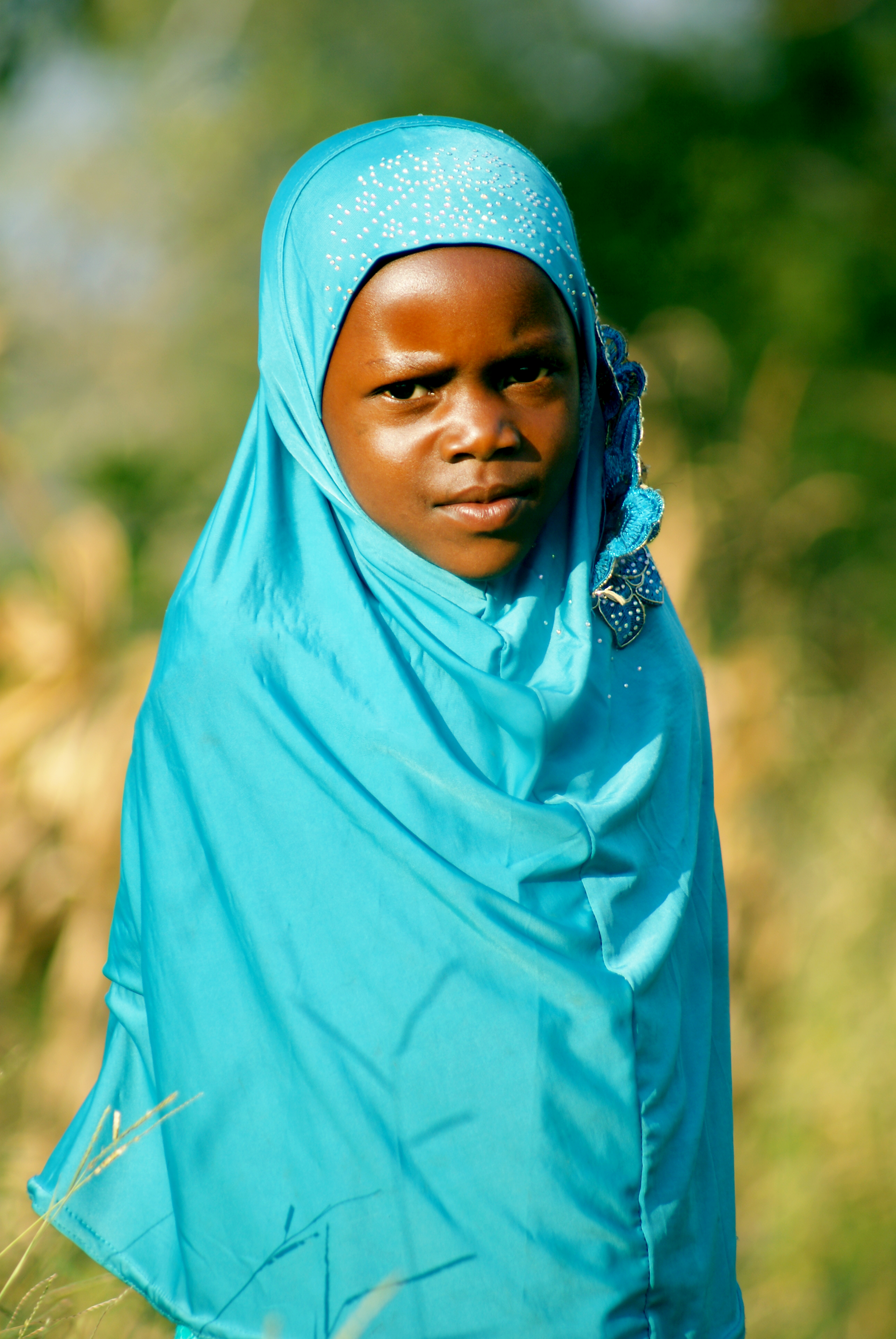 Selective Focus Photography of a Person Wearing Blue Hijab