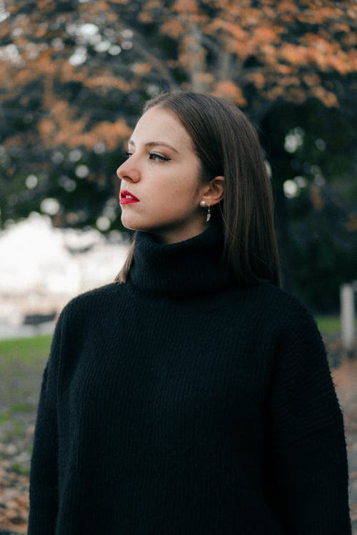 Selective Focus Photography of Woman Wearing Black Turtleneck Top