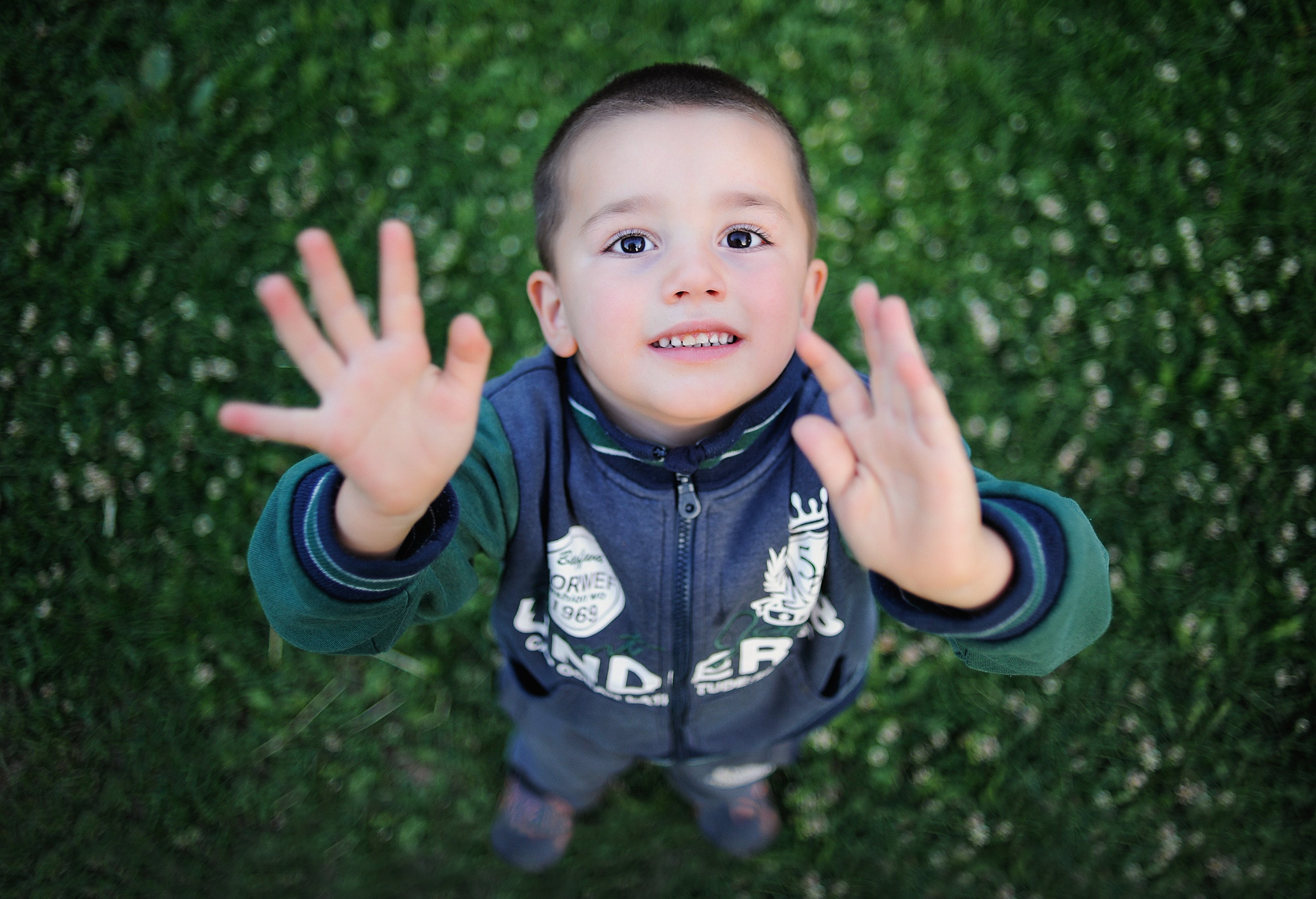 Portrait of Smiling Boy With Arms Outstretched