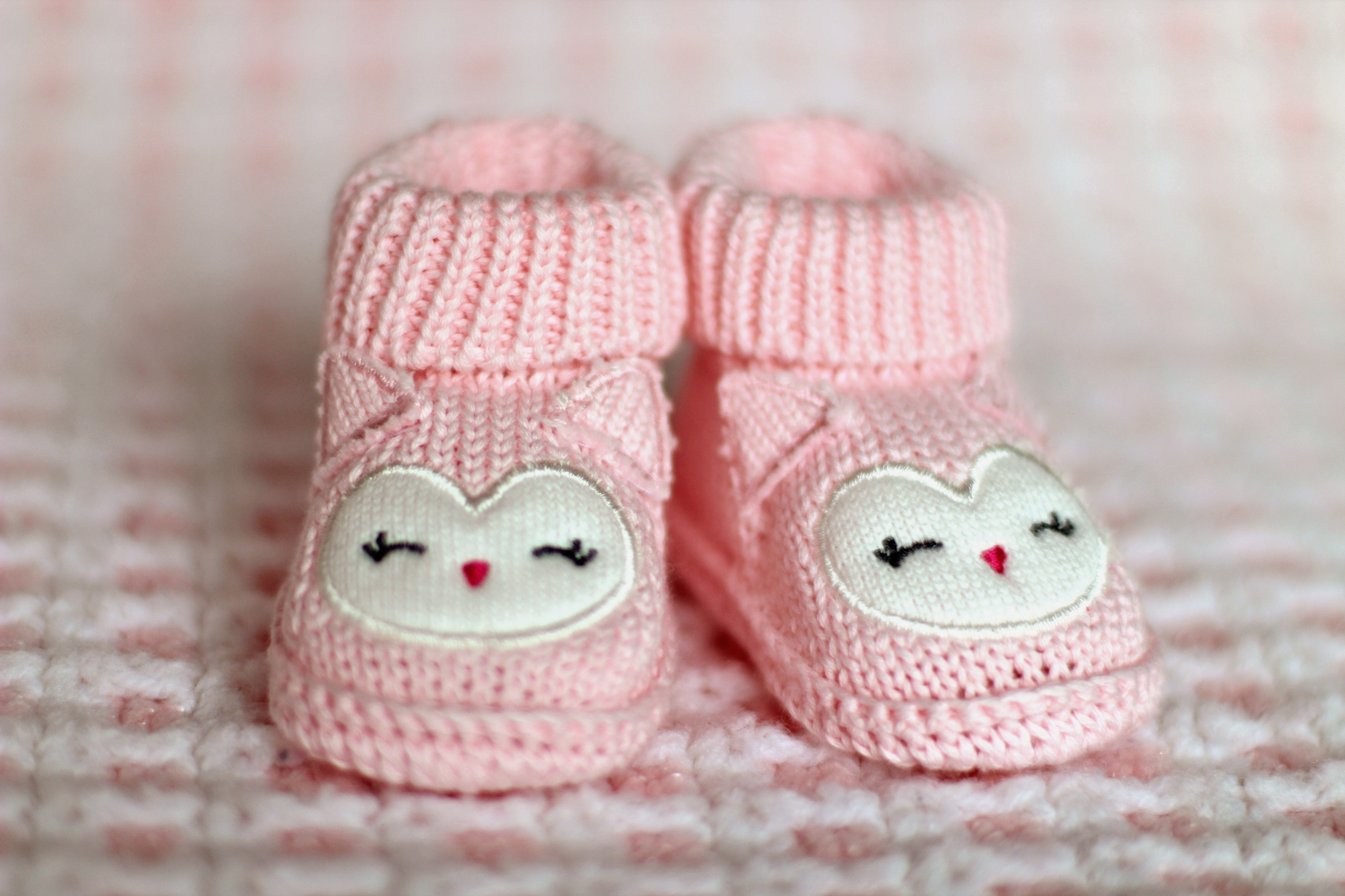 77e39575f12 Close-up of Pink Baby Booties · Free Stock Photo
