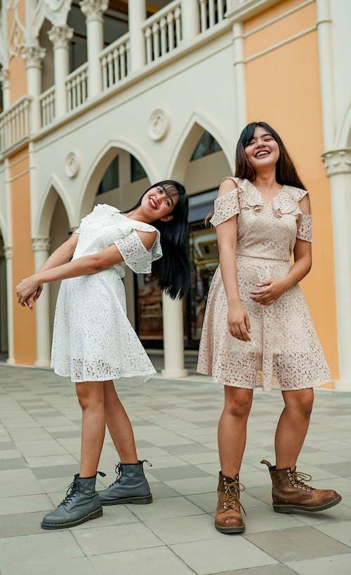 Two Women Wearing Dress