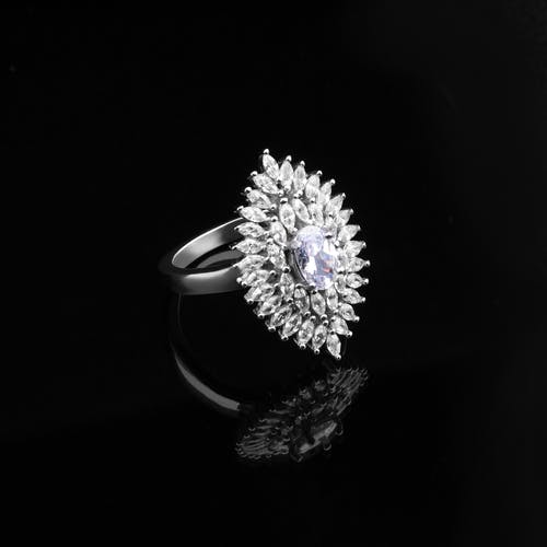 Grayscale Photography of A Ring With Diamonds
