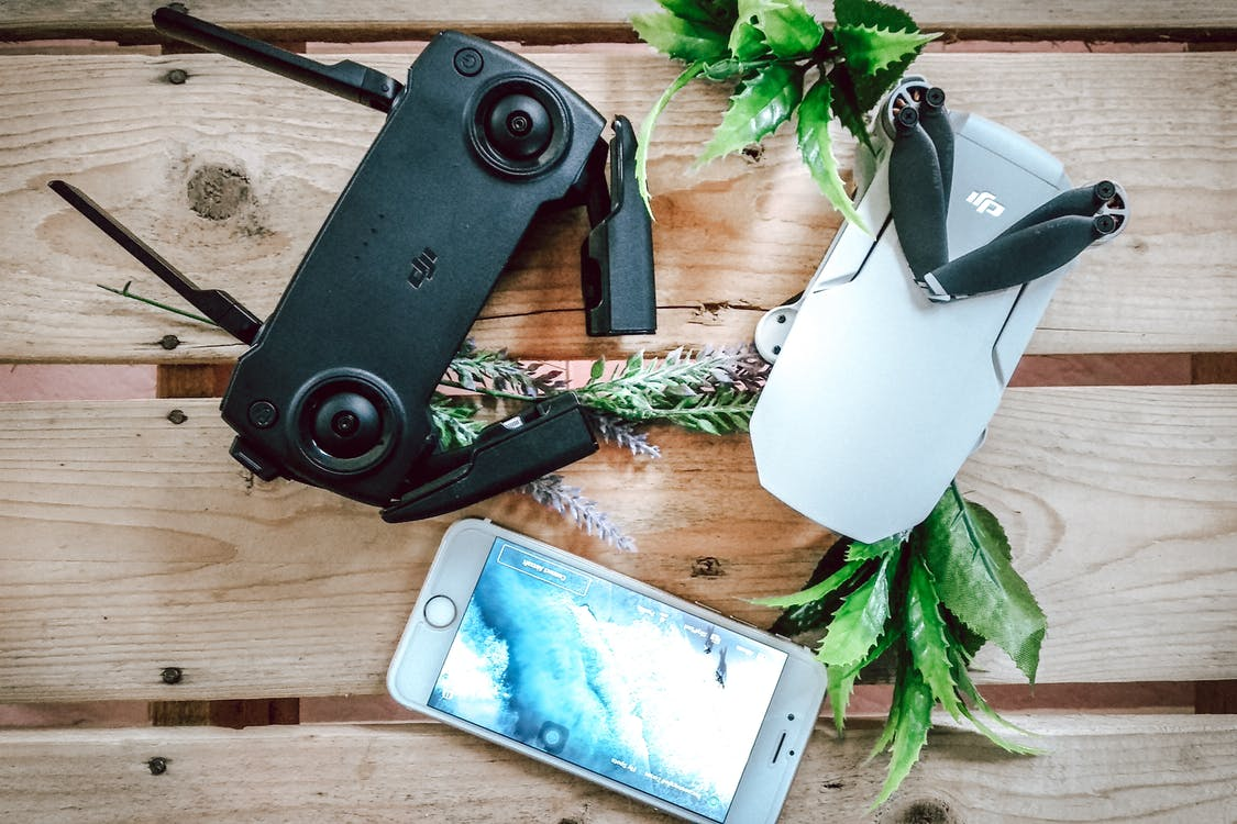 Dji Controller Beside Iphone