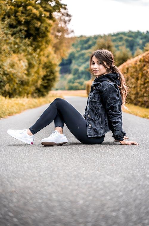 Photo of Woman Sitting on Pavement