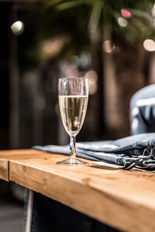 Champagne Glass on Brown Wooden Table