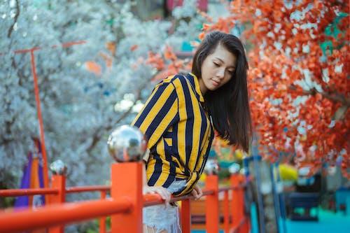Woman Wearing Blue and Yellow Pinstriped Shirt