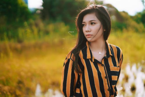 Woman in Black and Yellow Striped Dress Shirt