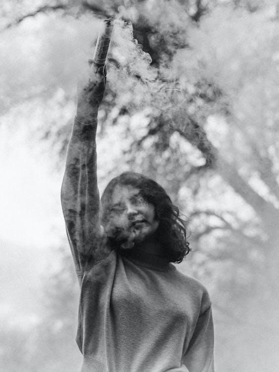 Woman Holding Smoke Bomb