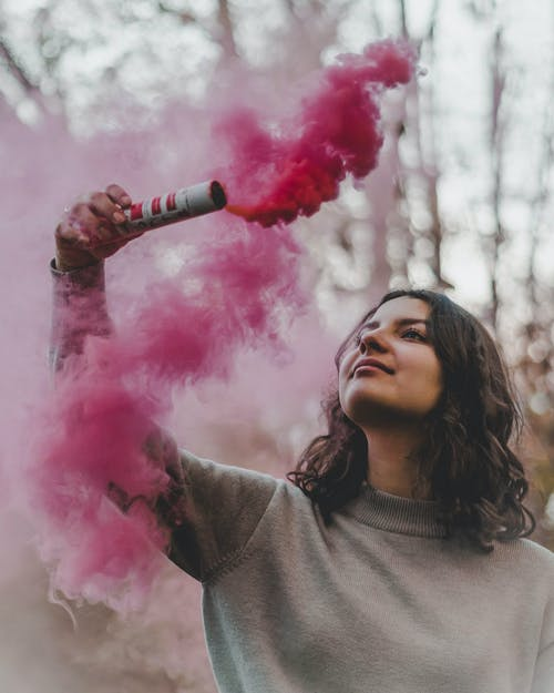 Woman Holding Pink Smoke