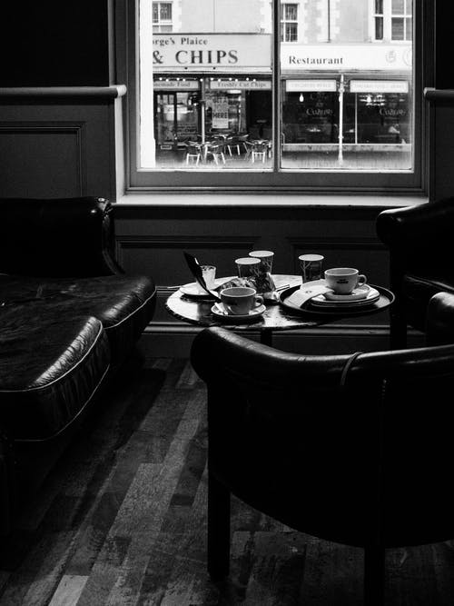 Grayscale Photography Of Inside A Coffee Shop