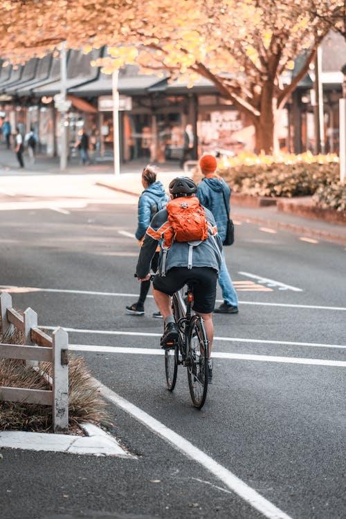 Person Riding Bike on Street