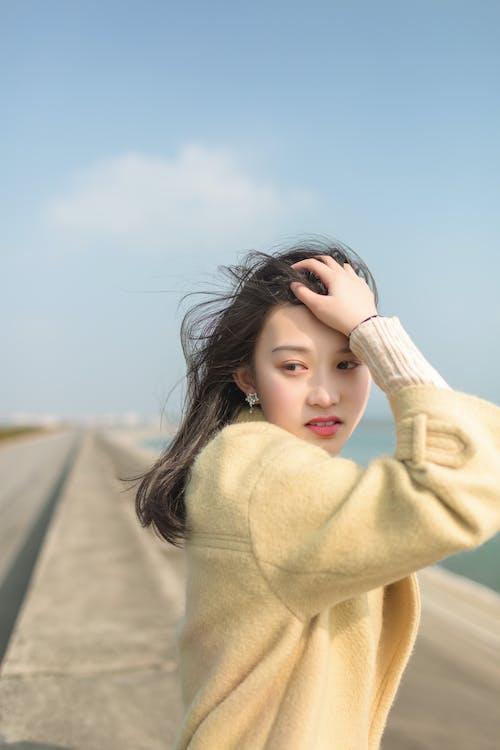 Photo of Woman Wearing Beige Sweater