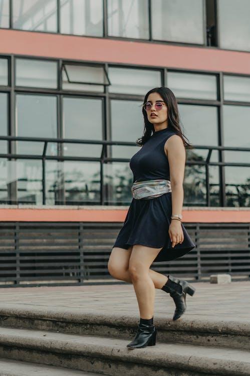 Woman Wearing Black Sleeveless Dress