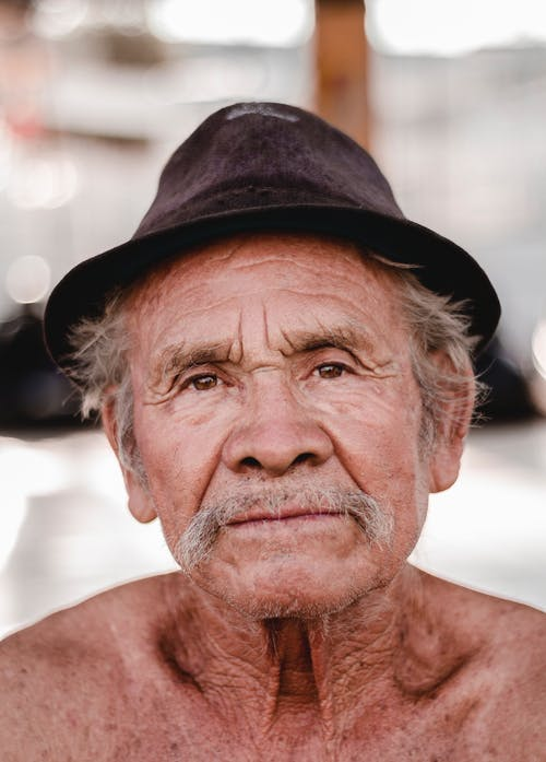 Photo Of Old Man Wearing Sun Hat