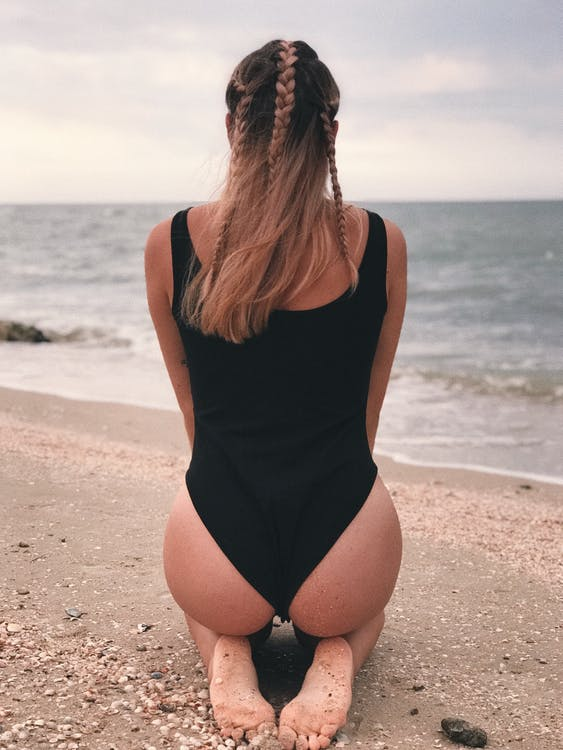 Woman in Black One Piece Swimsuit Standing on Beach