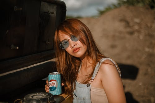 Woman Holding Soda Can