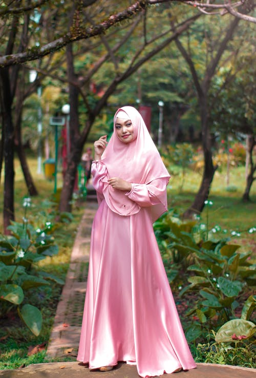 Woman Wearing Pink Abaya Dress
