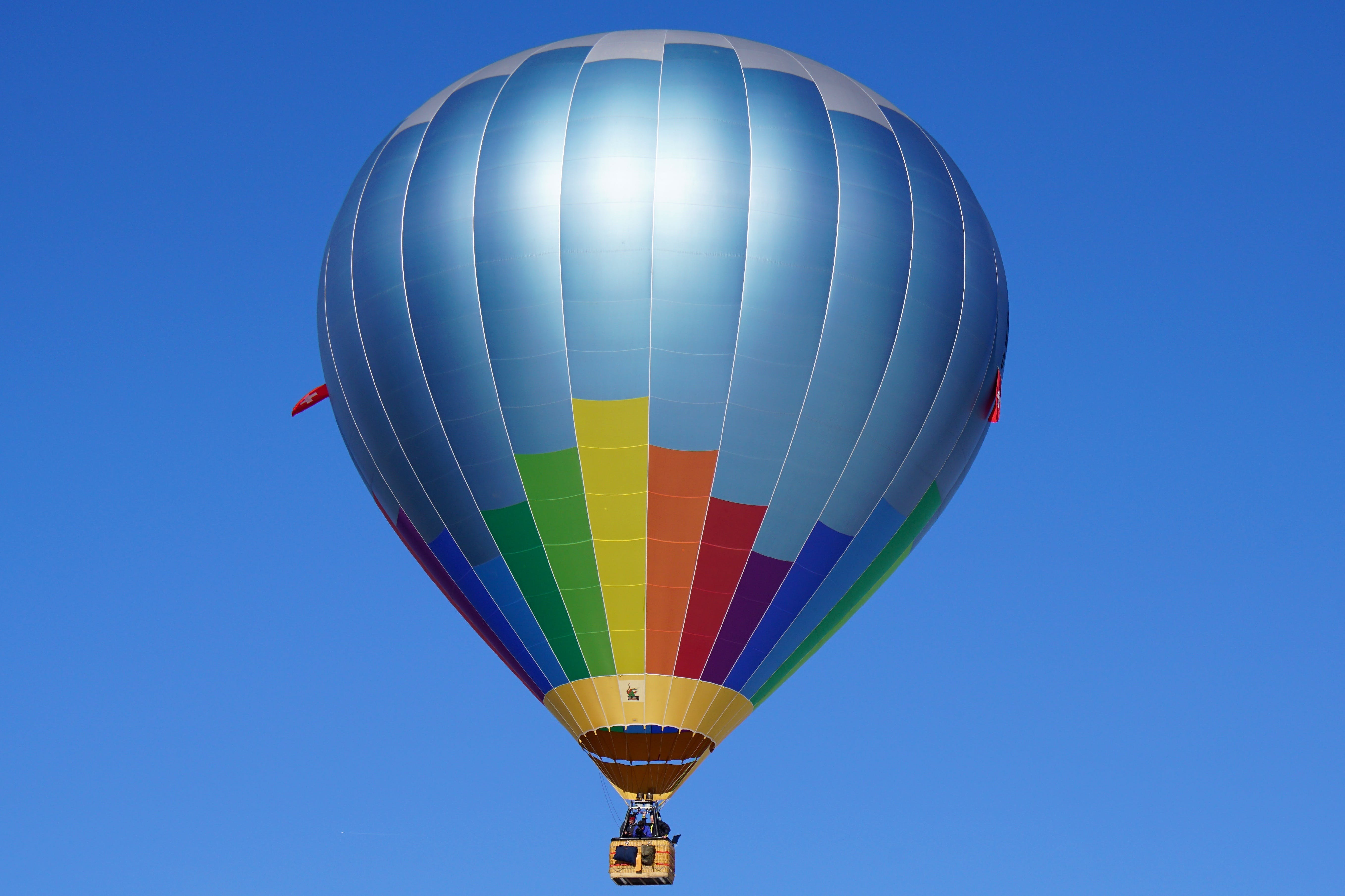 Hot Air Balloon Flying Against Blue Sky
