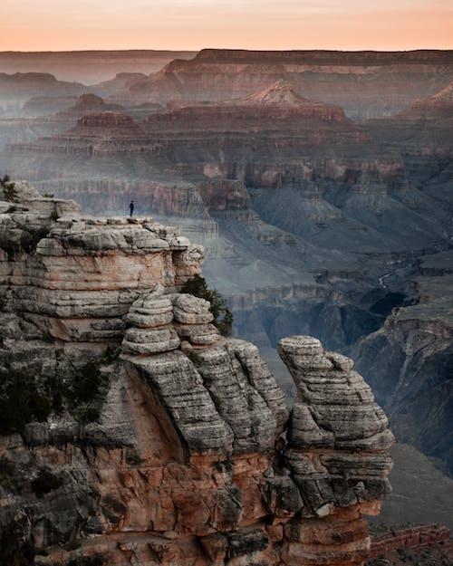 Brown Rocky Mountain Under White Sky