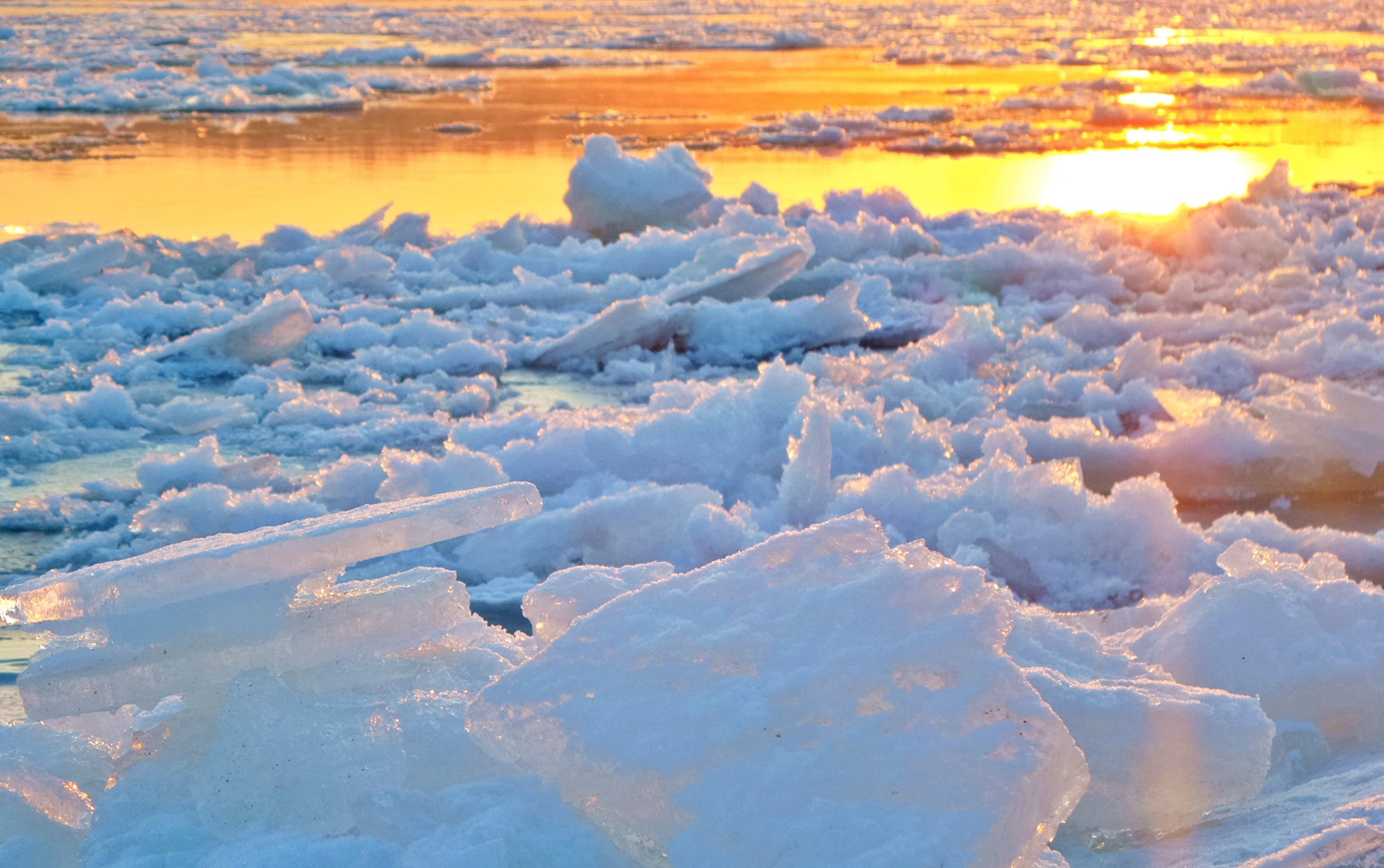 View of Frozen Lake during Sunset