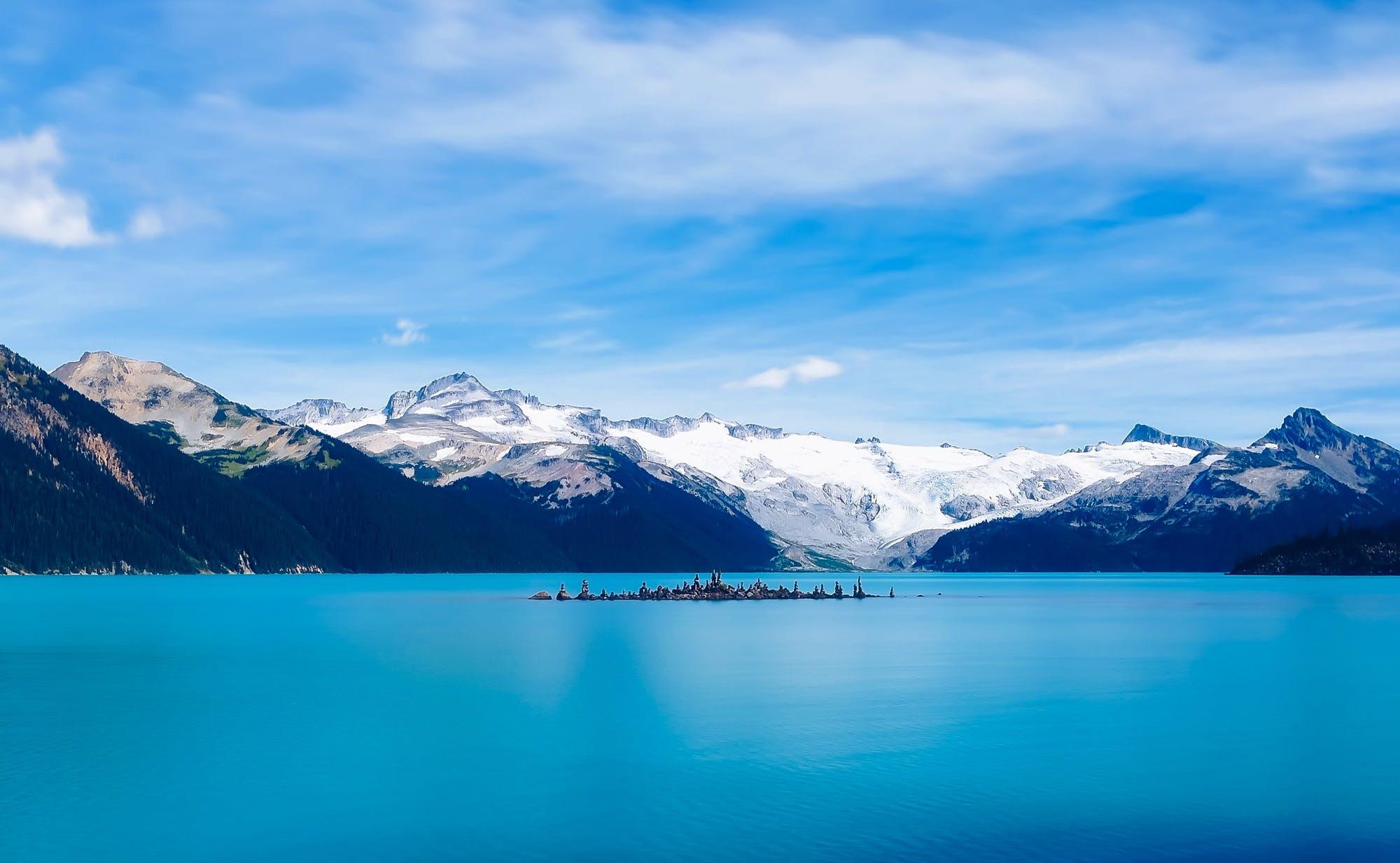 Scenic View of Frozen Lake Against Mountain Range