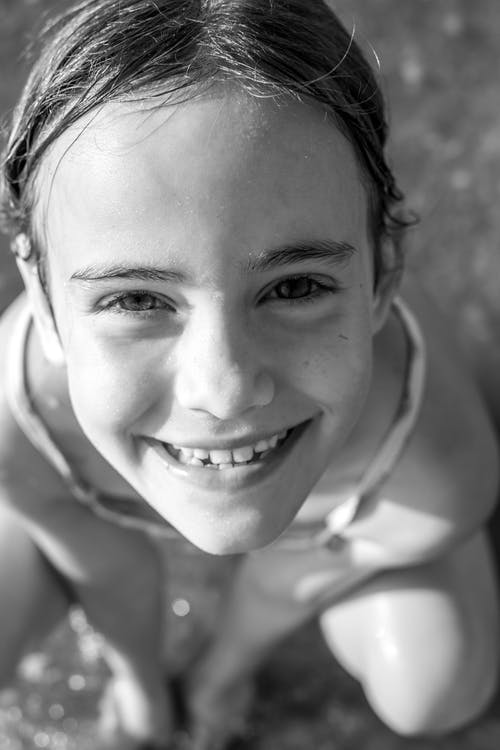 Grey-scale Photo of Girl smiling