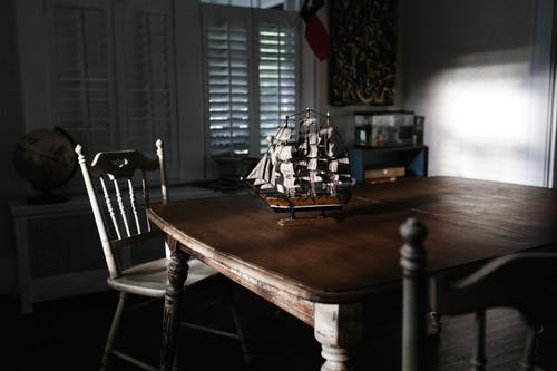 Selective Focus Photography of Miniature Ship on Table