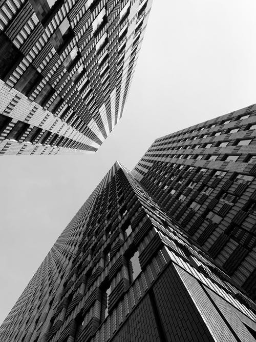 Grayscale Low-angle Photo of High-rise Buildings