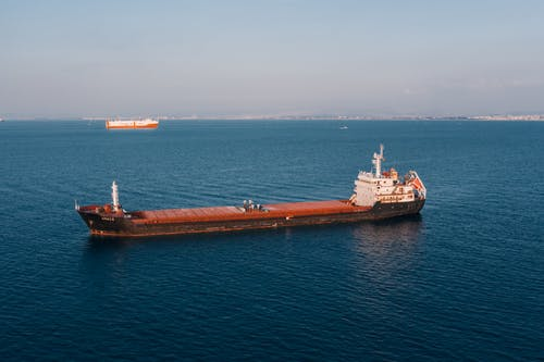 Brown and White Cargo Ship