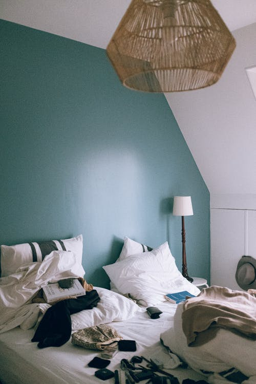 White Bed Beside Table Lamp