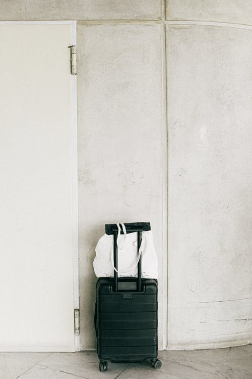 Black Luggage Bag Beside Door