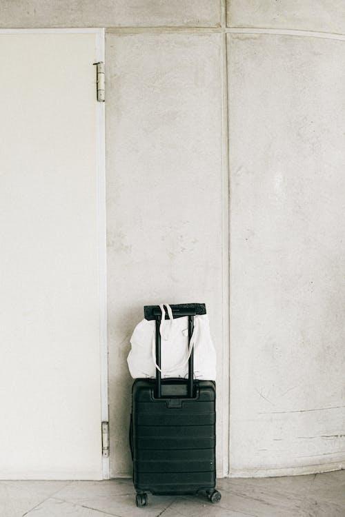 Black Luggage Bag Beside Door