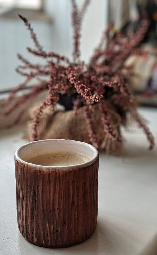 Brown Ceramic Mug With Brown Liquid Inside